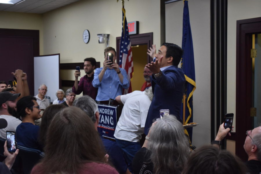 "Presidential candidate Andrew Yang speaks at a rally in Plaistow, New Hampshire. Yang has built a campaign off of a commitment to the issues, zeroing in on universal basic income and how best to adapt to automation. ""I don't feel like any of us on this campaign feel like figuring out who has the best solutions comes from attacking one another as candidates,"" Yang's deputy press secretary Hilary Kinney said."