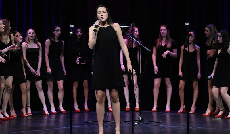 Senior+Arden+Knapp+sings+at+an+a+cappella+concert.+She+is+one+of+the+directors+of+the+Muses%2C+the+all-girls+group.