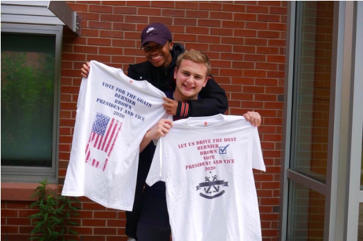 Student council president, Shawn Bernier, and Vice President CJ Brown pose with their campaign shirts outside of the commons. The duo created an instagram page as well as merchandise in hopes of rallying support during their campaign.