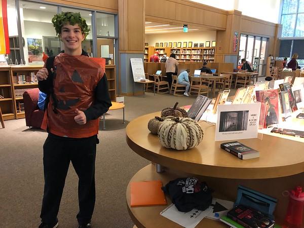 Senior Simon Fidlin dresses up as a jack o'lantern for Halloween 2019.