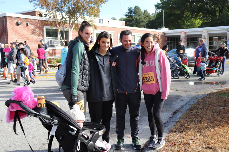 """Senior girls soccer co-captain, Ciara Murphy, gathers with team members and Coach Guy at the 2018 Pam's Run.  """"It's great to see how many people come to support it and how excited people are to participate,"""" said senior girls soccer co-captain Carly Camphausen"""
