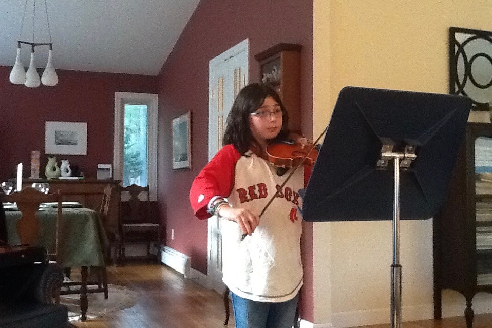 "Young Sam Baron practices the viola. ""My favorite part about playing the viola is that it is different,"