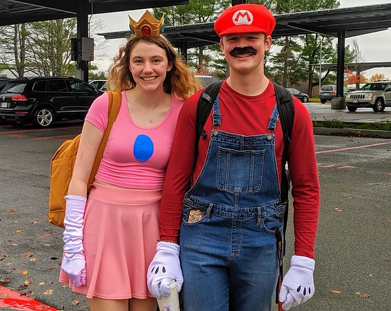 Seniors Shae Hanlon and Jack Brown roll with a nintendo themed costume as characters Princess Peach and Mario from the retro game, Super Mario.
