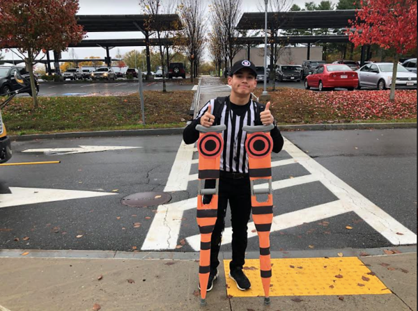 George Natsis followed the senior tradition of dressing up for Halloween. He dressed up as a football referee.