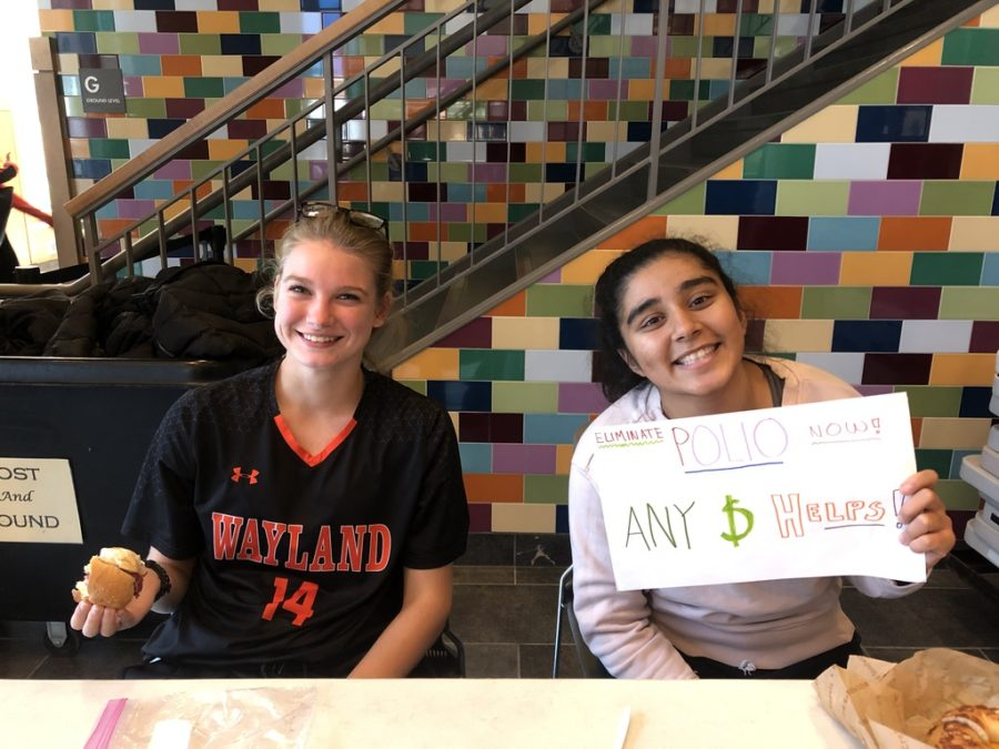 Seniors Rohini Ramesh and Molly O'Driscoll run the fundraising table.