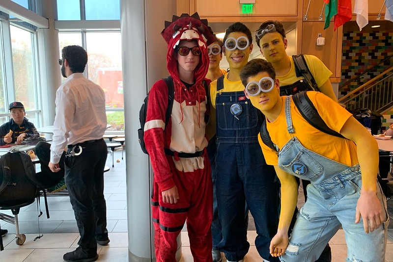 John Stafford is one of many  Fortnite characters. Next to him, Zeke Betancourt, Josh Ellenbogen and Sidney Toga show off their minion costumes. My favorite part of the costume is the hood, Stafford said.