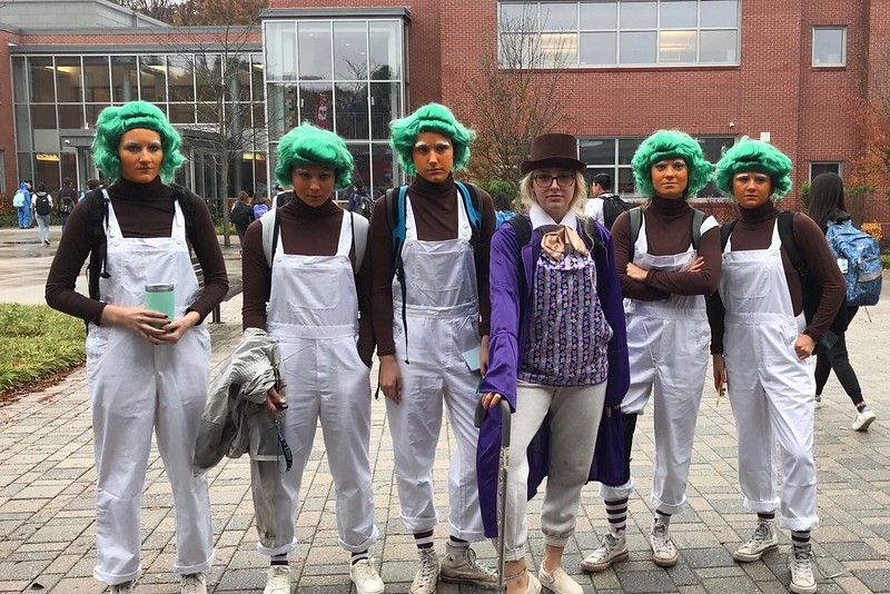 Seniors Izzy Van Rooyen, Ciara Murphy,  Adren Knapp, Maddie Olstein, Carly Camphausen, and Caroline Lampert pose together as Oompa Loompas and Charlie from Charlie and the Chocolate factory.