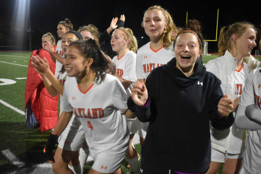 Wayland+girls+soccer+cheers+from+the+sideline+of+their+game+against+Acton-Boxborough.+Girls+soccer%2C+as+well+as+boys+soccer+and+football+are+onto+the+next+rounds+of+their+respective+playoffs.++