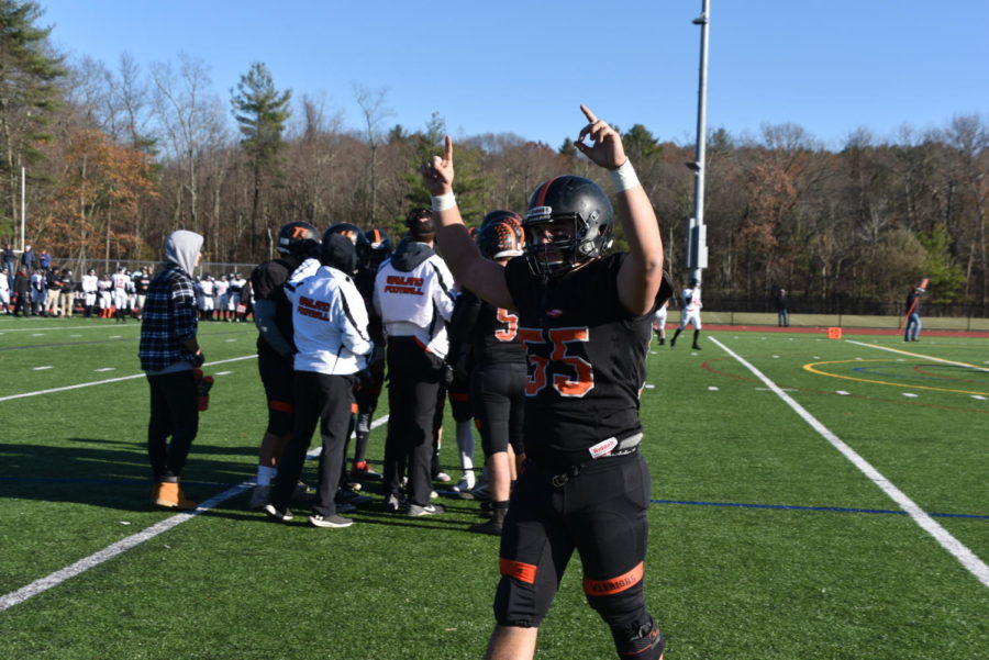 Senior Dante Parseghian celebrates an excellent defensive stop. Parseghian is a leader on the defensive line and a long snapper for the Warriors.
