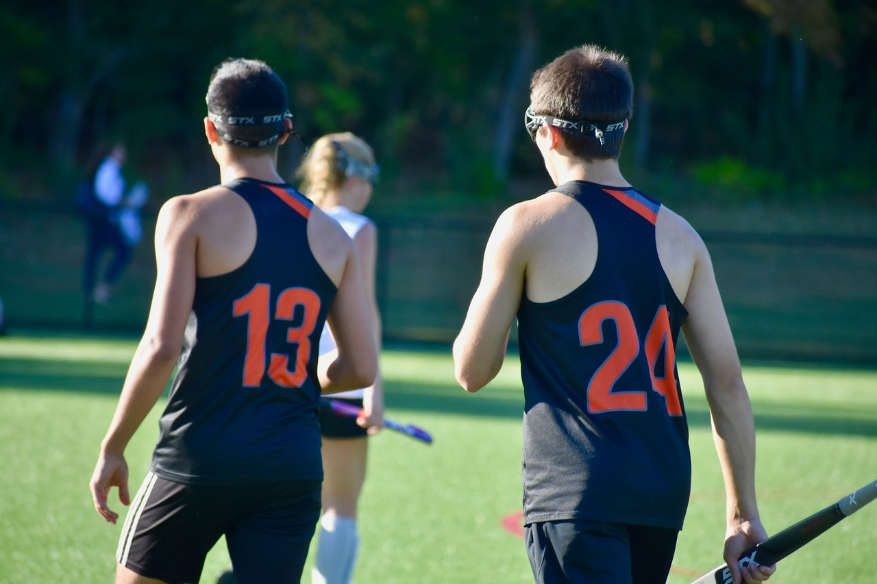 Seniors Zeke Betancourt and Aiden Chitkara walk in unison during a game versus Weston on Sept. 25. Both seniors, as well as Zeke's twin brother Ethan Betancourt, decided to play field hockey this year despite it being a predominantly female-played sport in the past. WSPN's Jimmy Paugh offers his perspective on their decision and the resulting backlash they have received.