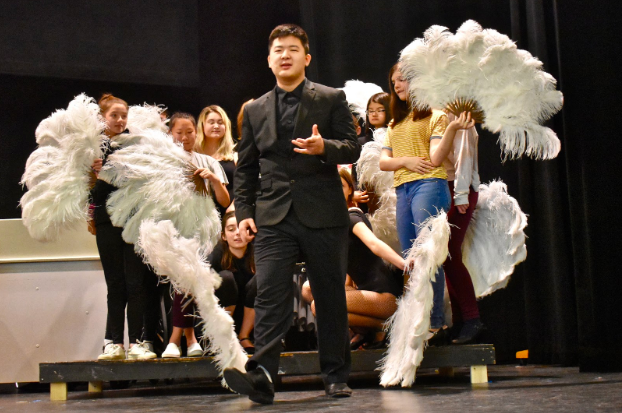 Junior Kaiyang Zhang rehearses for a scene in WHSTE's fall production of