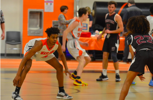 Junior Jabari Nurse gets into his defensive stance as he prepares to pressure the ball. Jabari recently left Wayland to go private for basketball, along with senior Jaden Brewington.