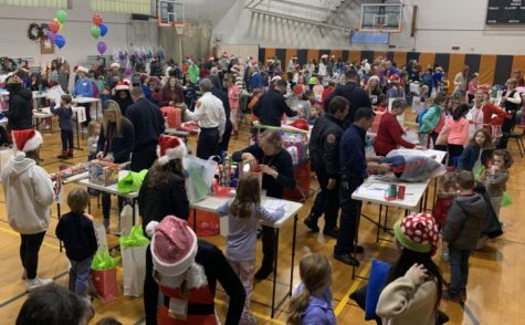 "The Wayland Holiday Shoppe just celebrated its 32nd anniversary in town. Beginning in the late 1980's, this event began when two Wayland residents proposed the idea to residents coming into the Council on Aging (COA), a program providing volunteer opportunities. The Shoppe hosts over 200 elementary school shoppers who are paired with student volunteers. ""Children just beam as they carry out their beautiful gift bags lined with tissue or wrapped boxes,"