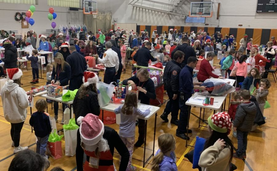 """The Wayland Holiday Shoppe just celebrated its 32nd anniversary in town. Beginning in the late 1980's, this event began when two Wayland residents proposed the idea to residents coming into the Council on Aging (COA), a program providing volunteer opportunities. The Shoppe hosts over 200 elementary school shoppers who are paired with student volunteers. """"Children just beam as they carry out their beautiful gift bags lined with tissue or wrapped boxes,"""