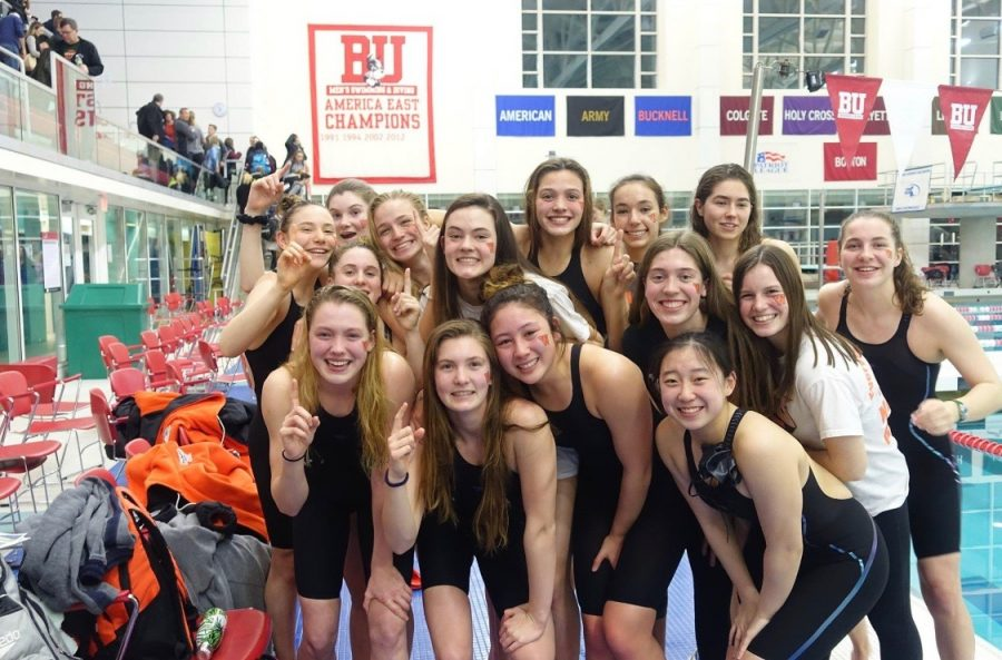 Last+year%27s+varsity+girls+swim+team+gathers+for+a+photo+after+a+meet.+%22%5BYou+make+varsity+by+scoring%5D+33-35+points+in+a+season%2C%22+Greenaway+said.+%22You+score+points+by+how+well+you+do+in+the+meet.%22+
