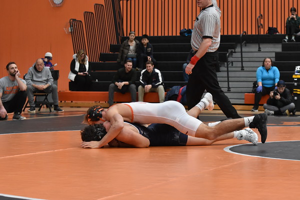 Senior+captain+Cameron+Jones+lays+out+his+opponent+early+in+the+match%2C+trying+to+pin+him+and+get+a+win+for+Wayland.