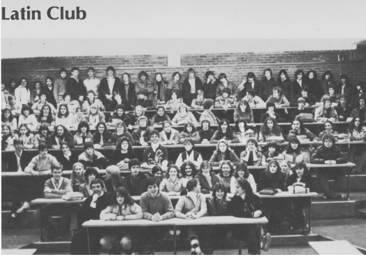 "Students from all grades taking many languages took part in the original Latin Club. The club was very popular, and in 1983, boasted 115 members. ""The Latin Club, under the direction of [founder Frank] Smith, is easily one of the oldest and most popular clubs at WHS,"" the WHS Reflector yearbook wrote in 1983. ""For over 20 years, club members have sponsored dances, banquets, dramatic productions and other activities revolving around classical and especially Roman Themes. This year's club ran a very profitable late summer car wash, sponsored it 22nd annual initiation ceremony, the Saturnalian Banquet, an evening of dramatic readings, a Medieval Pilgrimage and a Greek Tragedy."""