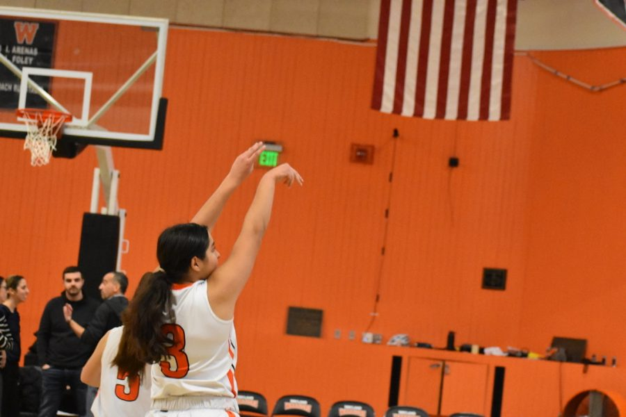 Sophomore Sarah Alizadeh shoots a three-pointer.