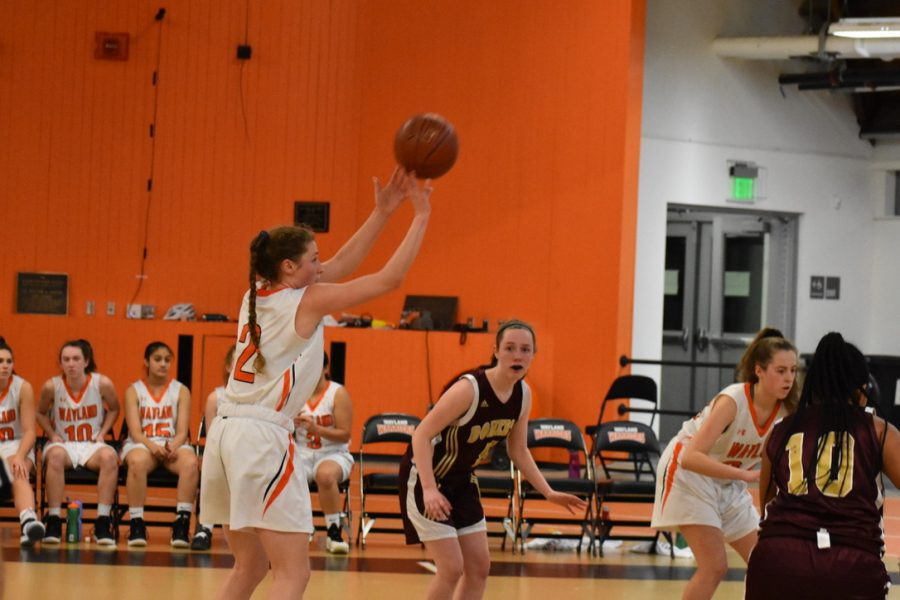 Senior Emma Kiernan shoots a three-pointer shot.