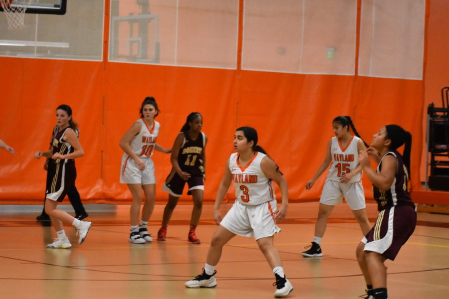 The Wayland Girls Varsity Basketball team set up in their defensive position.