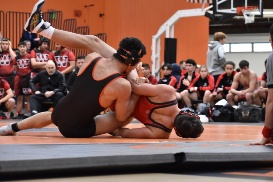 Senior Marcos Pereira hits a tilt in an attempt to score back points on his opponent.