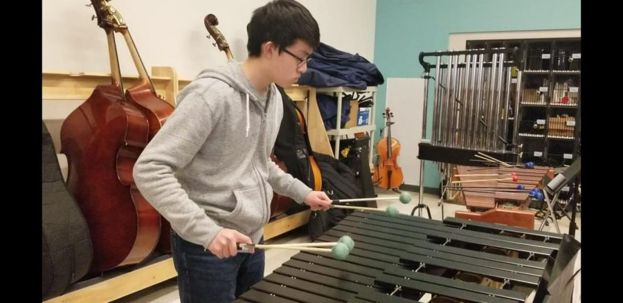 """Junior Mingle Li is practicing in the WHS band room for the upcoming All-State Festival. While Li secured a spot in the 2020 MA All-State Festival, preparation is essential. """"I'm enormously proud of all the students who earned the recommendation, because that in itself is an incredible distinction and for a school of our size to have 11 kids accepted,"""" Director of the Fine Arts Department Susan Memoli said."""