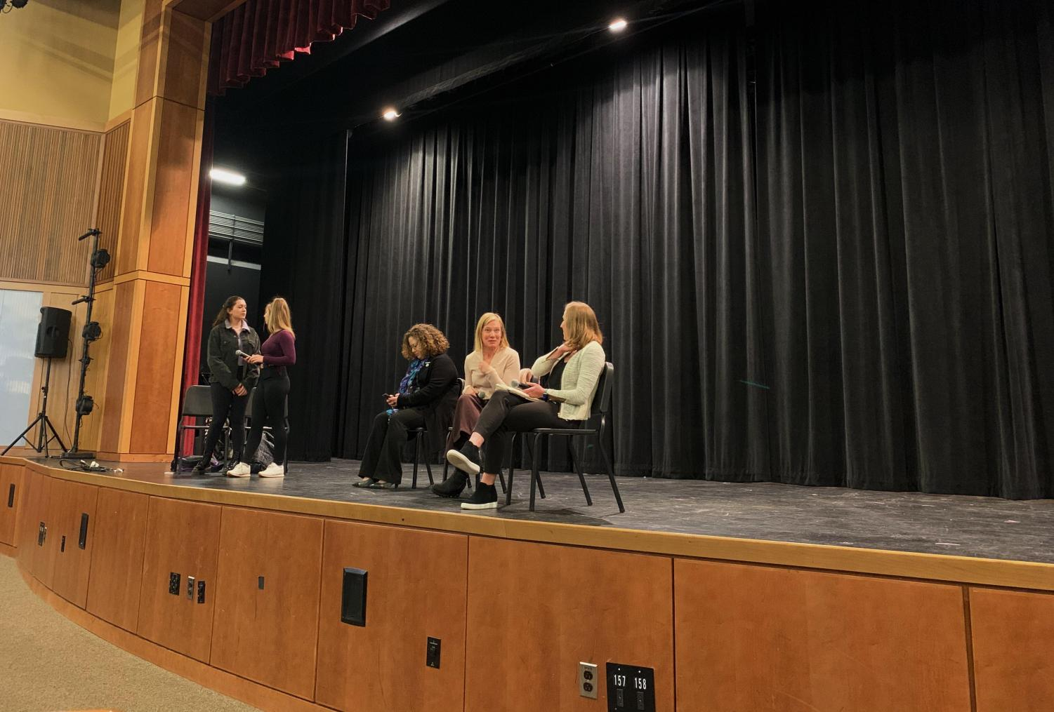Panel speakers Becca Rausch, Angela Ferrari, and Foster Newcome prepare to speak about their life as working women.