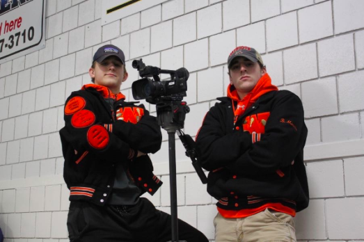 Boys varsity hockey team managers seniors Timmy Goodfellow and Brett Morris take on many jobs, one of them being filming games.