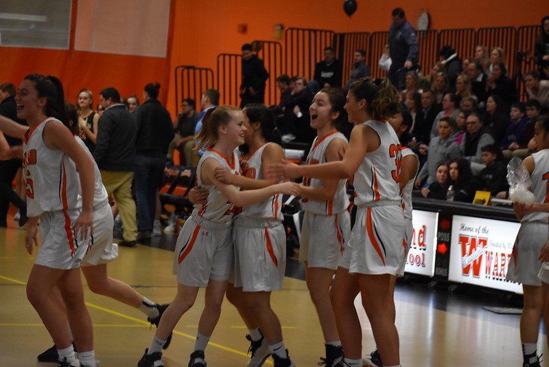 The+girls+varsity+basketball+team+celebrates+after+its+first+playoff+game+win+against+Hopkinton.+The+team+fell+in+their+quarterfinal+game+last+Thursday+against+Medfield.+WSPN+reviews+and+previews+the+seasons+of+the+team+along+with+other+winter+sports.