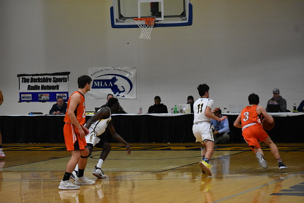 Junior+captain+Porter+Moody+drives+as+he+goes+up+for+the+layup.+Moody+would+soon+be+defended++by+two+Taconic+players+as+he+went+for+the+basket.