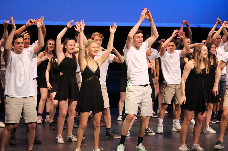 The class of 2019 puts their hands up in unison during the traditional co-ed dance.