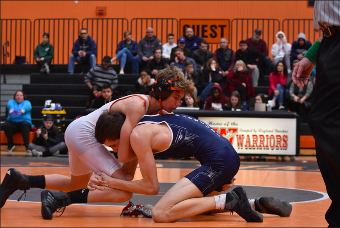 Sophomore Finn O'Driscoll wrestles a Lincoln-Sudbury wrestler. O'Driscoll, among others, gained a close relationship with former athletic trainer Chris Morash.