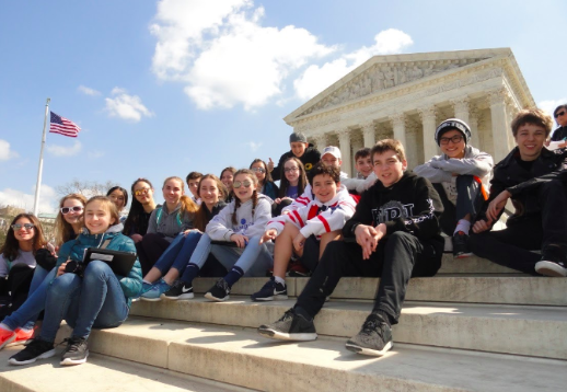 "Members of the class of 2022 gather for a picture outside of the Lincoln Memorial at their D.C. trip. This year, eighth graders will not be going to D.C. due to the Coronavirus. ""It was definitely a smart decision to cancel the trip considering we are in a pandemic,"