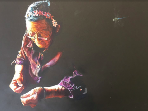 "Sophomore Lily Yu creates a drawing of an old woman. Yu won a National Gold Medal from Scholastic for this piece. ""I think art is a lot like music because it makes up for the shortcomings that every language has,"
