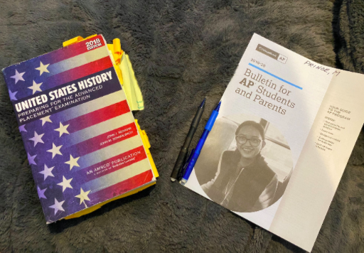 Two AP books and pencils lie on a student's bed. This year's AP tests are being moved to online and shortened to 45 minutes due to Coronavirus.