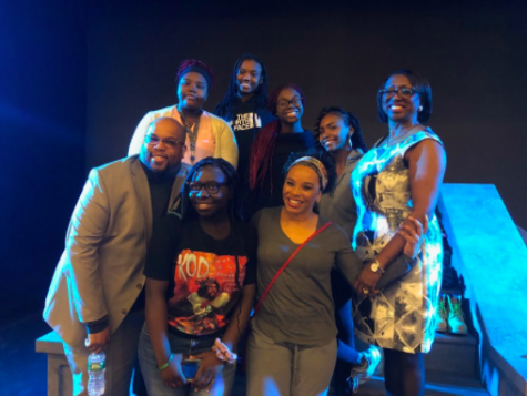 Former METCO director Mabel Reid-Wallace poses with METCO coordinator Mark Liddell, METCO students, and actress Debra Walton following Walton's performance of