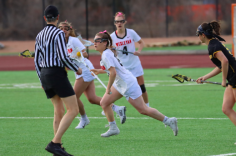 WHS graduate Kate Balicki races past her defender and down the field. Balicki is just one of many athletes whose season was cut short by COVID-19.