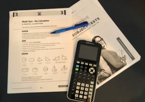 A calculator and pencil rests upon an SAT math practice test. In March, standardized tests began to cancel due to preventing the spread of coronavirus, so some colleges are moving towards becoming test optional.