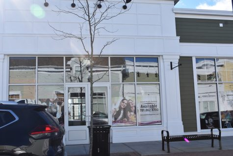 The Wayland town center is still looking for businesses to fill the vacant lots. Signs with information about leasing opportunities in order to try and fill empty spaces have been hung in the windows.