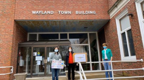 "Wayland residents are seen donating masks to Traditions of Wayland Senior Living. The masks were fundraised for by the from the Huanggang High School Alumni Association. ""We're all in this together--it's not the Chinese vs the rest of the population,"" WHS senior Amelia Ao said."