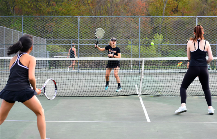 Girls+varsity+tennis+captain+senior+Mallory+Leonard+plays+on+the+old+courts+that+have+since+been+replaced+in+construction.+Leonard+and+her+teammates+have+not+been+able+to+play+on+the+new+courts+due+to+cancellations+caused+by+COVID-19.+%E2%80%9CThis+season+we+were+so+excited+to+get+to+play+on+the+new+courts+out+front+that+we+have+been+waiting+for%2C%E2%80%9D+girls+varsity+tennis+captain+Emma+Levy+said.+%E2%80%9CIt+is+sad+to+know+I+will+never+get+to+play+a+match+on+them.%E2%80%9D