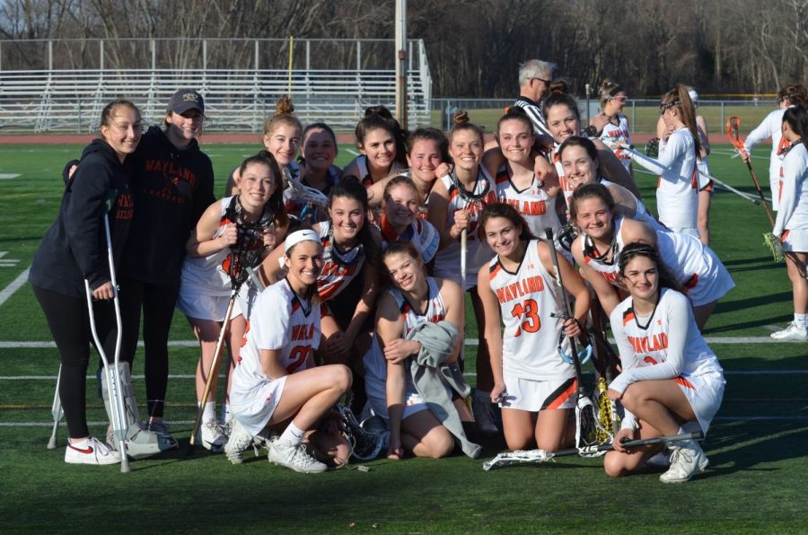 "Members of the 2019 varsity girls lacrosse team get together after their game. This year, all spring senior athletes were denied their final spring season. ""Volleyball is really the unfinished chapter of my high school athletic career,"" said Davies. ""It's just sad that I will never get to leave the impression that I would have liked to in volleyball."""