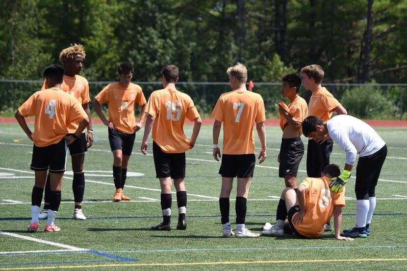 The Wayland boys soccer team talks during a preseason game up in Maine. This year