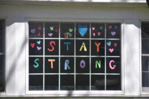 Many people around town have been decorating their homes with stickers and posters to keep the community strong during hard times like these.