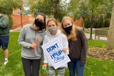 "Wayland High School 2020 Graduate Caroline Raymond (middle), stands with some of her friends on campus at Bentley University. ""I think our college is handling the Coronavirus very well considering there is only one case,"" Raymond said. ""The students and staff are very good about following the rules, which really helps."""