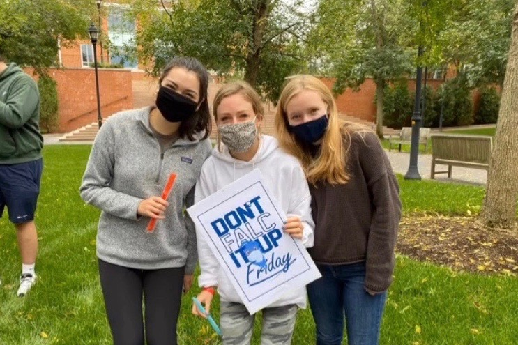 """Wayland High School 2020 Graduate Caroline Raymond (middle), stands with some of her friends on campus at Bentley University. """"I think our college is handling the Coronavirus very well considering there is only one case,"""" Raymond said. """"The students and staff are very good about following the rules, which really helps."""""""