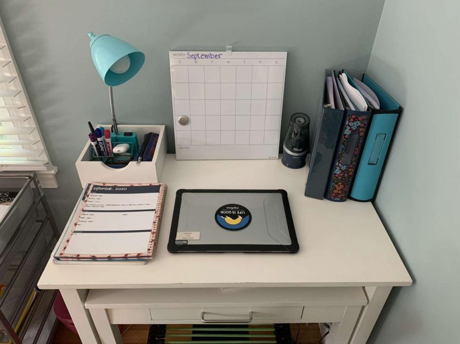 Junior Haley Melvin shows her workspace she has created in the comfort of her home. Having a designated area to do work is extremely important in these times of online learning.
