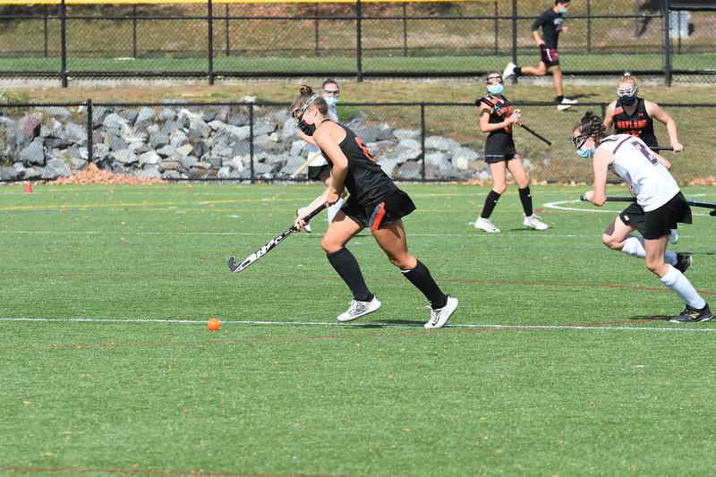 Senior captain Ella L'Esperance runs the ball down the field, ready to make a play.