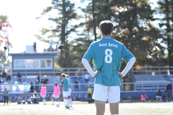 Junior Garrett Spooner waits for ref to blow his whistle, signaling the start of the game.