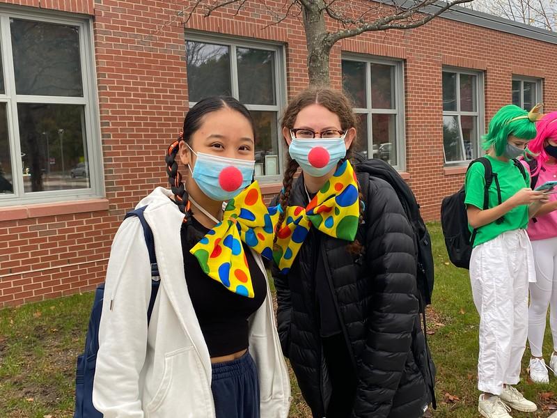 Seniors Anna Lin and Emily Rubin smile underneath their masks as clowns for Halloween.